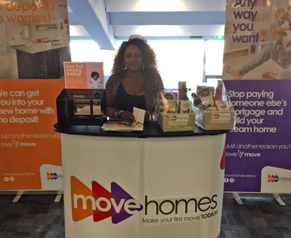 Marie Odongo at the Move Homes' stall at Africa Day event by OAC
