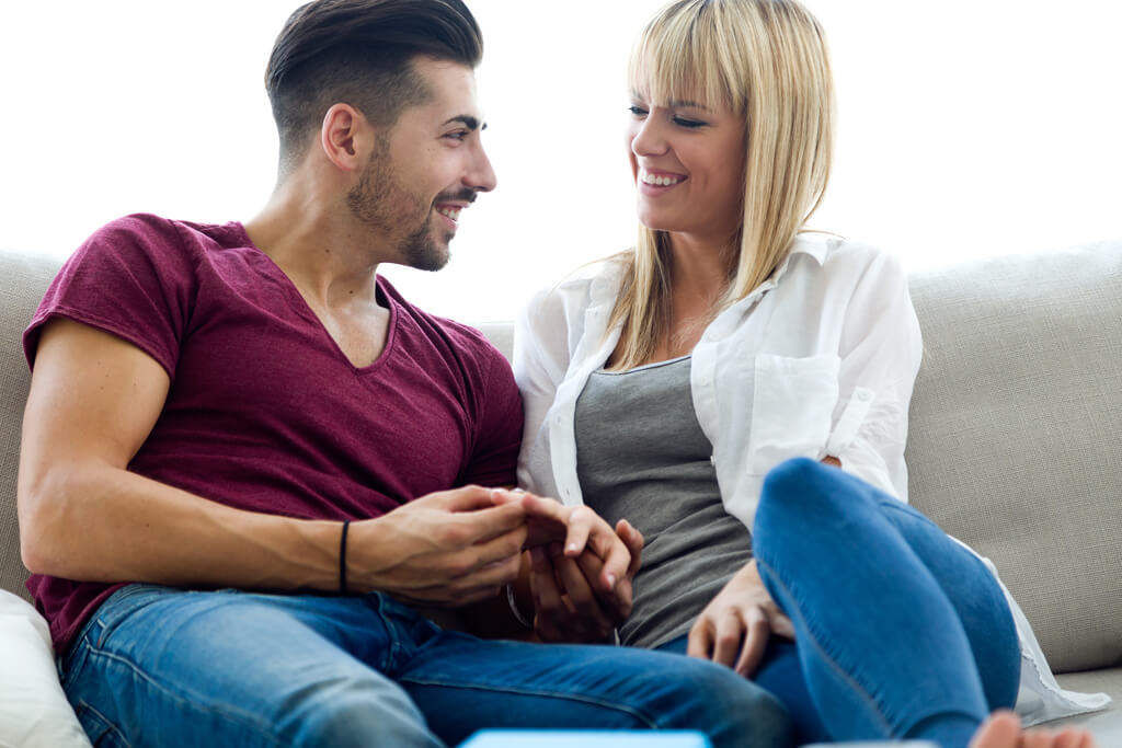 Beautiful young couple in love at home after getting help from Keystart