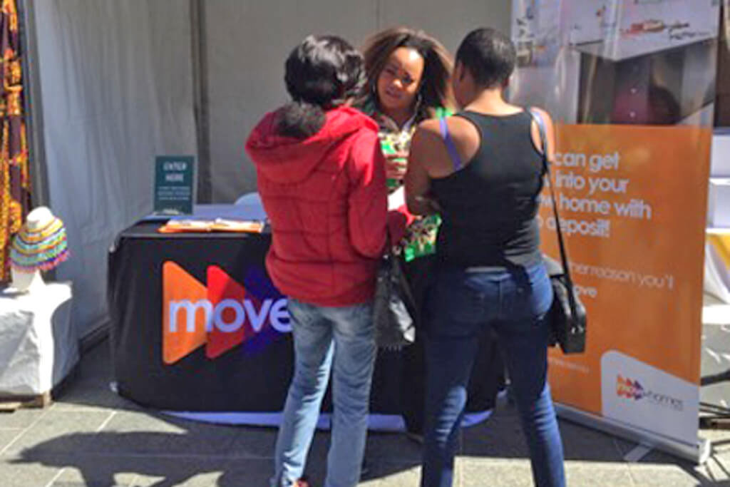 Marie Odongo at the Africa Trade and Cultural Expo speaking to first time home buyers in Perth