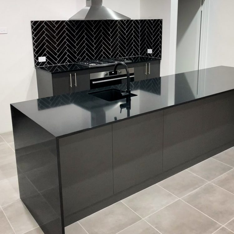 Nero Assoluto Gloss stone bench top in a first home buyer kitchen