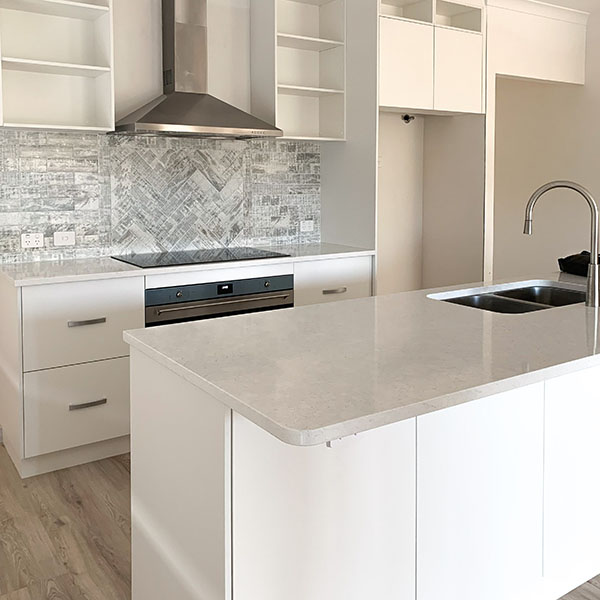 Fino Venato stone bench top in a kitchen by Move Homes in South Guildford