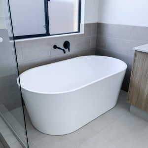 brand new bathroom with a free standing tub
