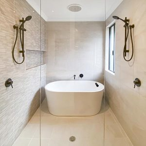 Custom ensuite with double showers and free standing bath