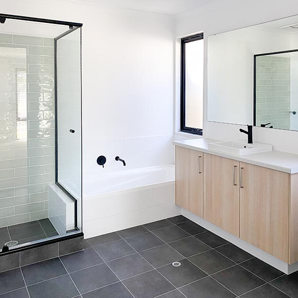 New ensuite with a bath for a first home buyer by Move Homes
