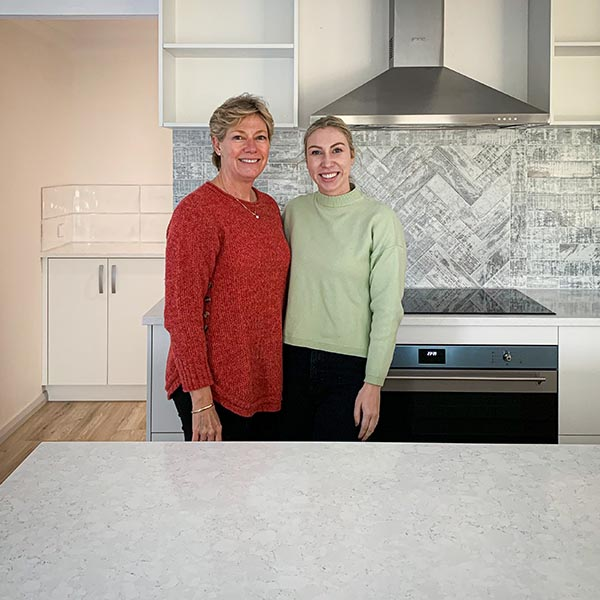 Catherine Burke with a client in a new home